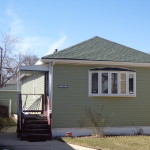 AFTER - BEAUTIFUL NEW ROOF , SIDING AND GUTTERS