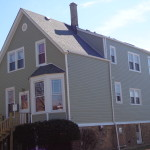 AFTER ROOF, SIDING GUTTERS AND WINDOW WRAPS